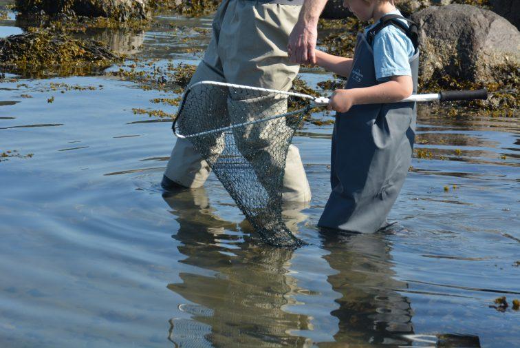 Far og sønn på fisketur Barnevaderen